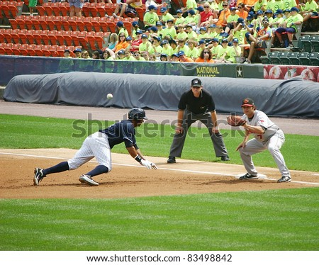 SCRANTON, PA - AUGUST 24: Scranton Wilkes Barre Yankees runner Chris Dickerson hustles back to first base in a game against the Rochester Red Wings at PNC Field on August 24, 2011 in Scranton, PA. - stock photo