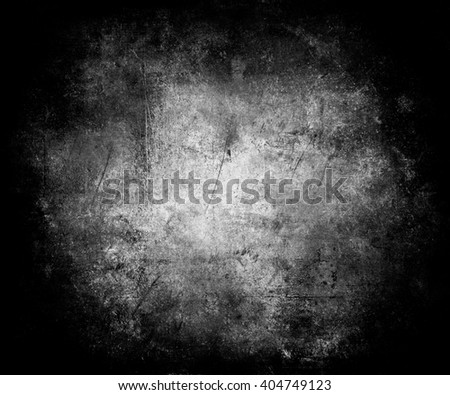 Scratched Vintage Grunge Black Background With Faded Central Area For Your Text Or Picture - stock photo