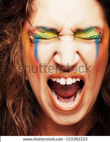 Screaming young woman with creative professional make-up  - stock photo
