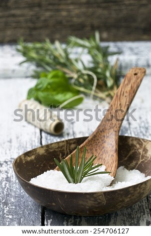 sea salt with herbs: basil and rosemary - stock photo