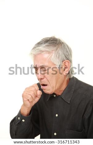 senior Japanese man coughing - stock photo