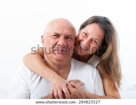 Senior  man and   woman  in   embrace. - stock photo