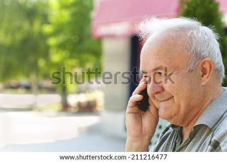 Senior man talking on the phone - stock photo