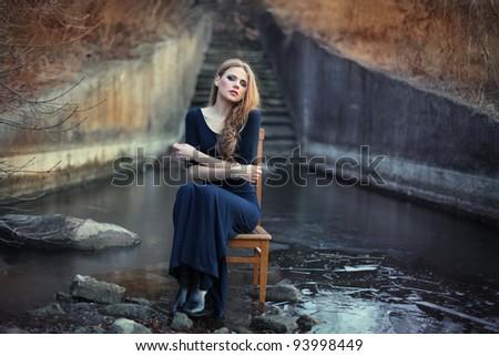 sensual beautiful girl sitting on chair on ice - stock photo