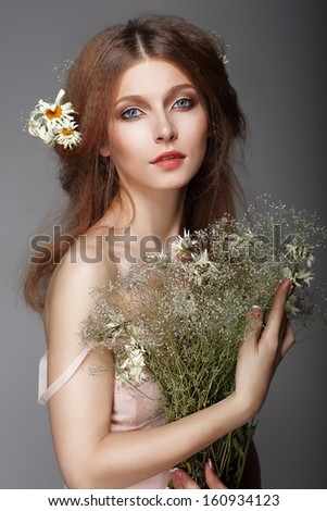 Sentiment. Portrait of Redhair Nostalgic Woman with Herbs - stock photo