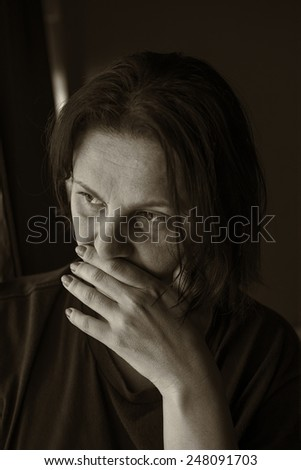 Sepia portrait of a sad woman - stock photo