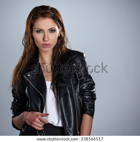 serious lady with smoky eye makeup - stock photo