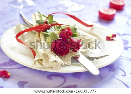 Served plate with napkin and rose in Valentine day - stock photo