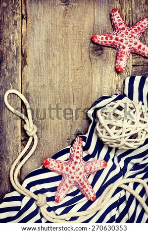 setting summer vacation : Candle in the form of starfish, shells on the wooden background (Toning) - stock photo