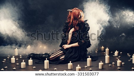 Sexy girl in witch costume for Halloween  - stock photo