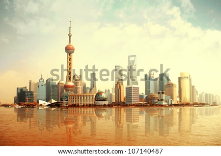 2012 Shanghai skyline, beautiful sunrise and sun. - stock photo