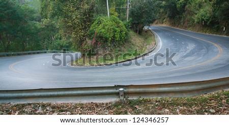 sharp curve road - stock photo