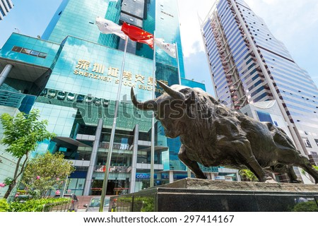 Shenzhen,China-June 15,2015: Shenzhen stock market building and bull sculpture - stock photo