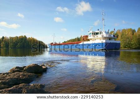 ship and rocks, Baltic sea, Saima channel in autumn                            - stock photo