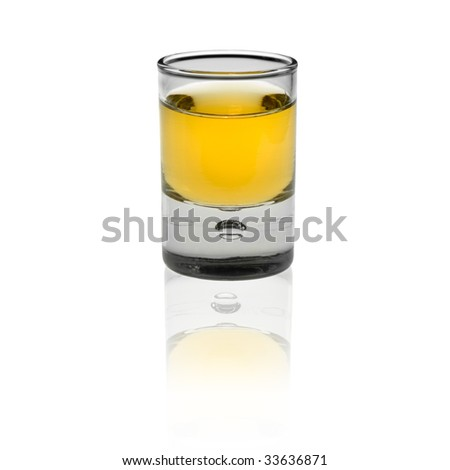 shot glas with alcohol isolated on white background - stock photo
