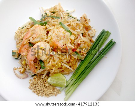"""""""Shrimp Pad Thai"""" Pad Thai is a Thai traditional food and now is well known and been popular in many countries. It has many flavor like sweet sour salty and some spicy depends customer's choice. - stock photo"""