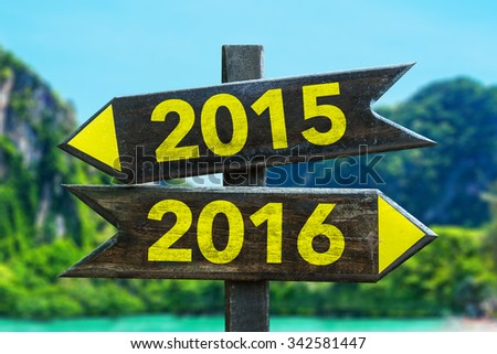 2015 - 2016 signpost in a beach background - stock photo
