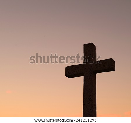 silhouette cross at sunset   - stock photo