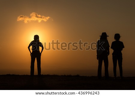 silhouette in sunset - stock photo