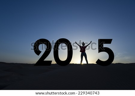 2015, silhouette of a woman standing in the sunrise - stock photo