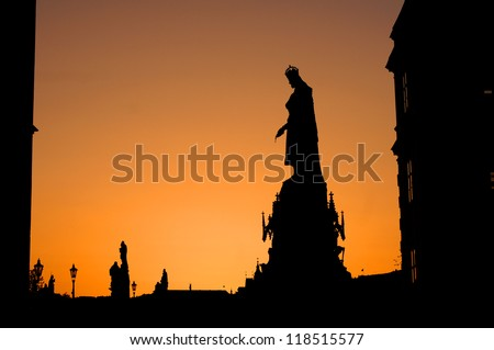 Silhouette statue of Charles IV statue by Arnost Handel 1848 on Charles bridge in Prague against sunset sky with cope space. - stock photo