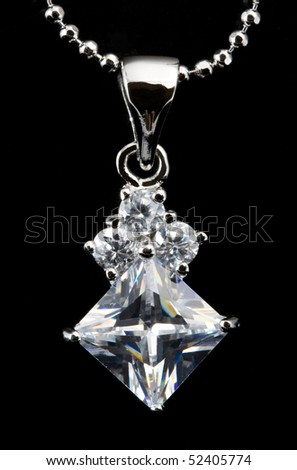 silver pendant with diamond - stock photo