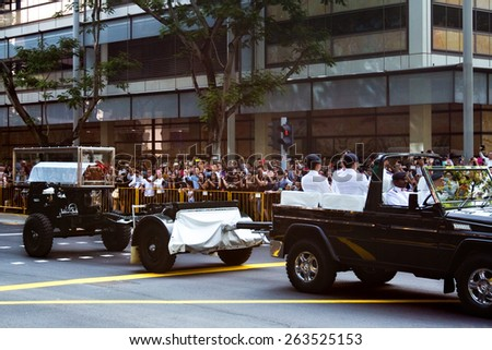 SINGAPORE - MARCH 24:Wooden casket carrying the body of the former prime minister of Singapore, Mr Lee Kuan Yew on gun carriage arrived at Parliament House for lying in state. Mar 24, 2015, Singapore - stock photo