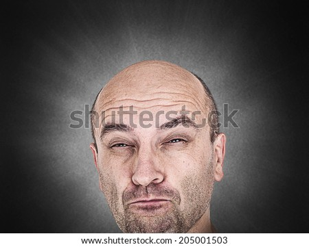 Skeptical man with funny grimace - stock photo