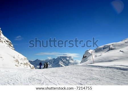 ski slope covered mountain side - stock photo