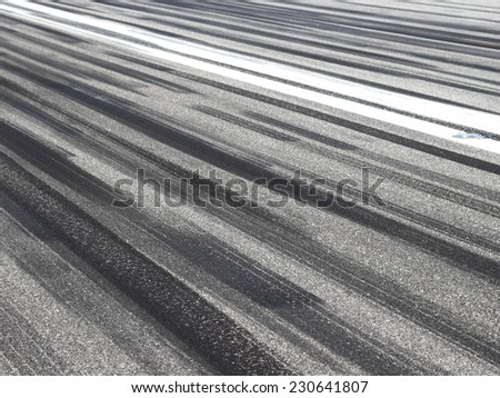Skid marks on runway - stock photo