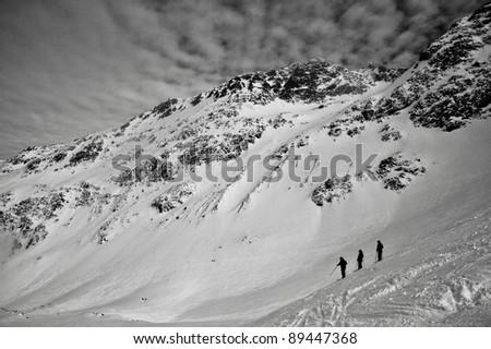 3 Skiers - stock photo