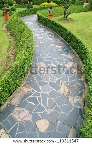 slate walkway in green garden - stock photo
