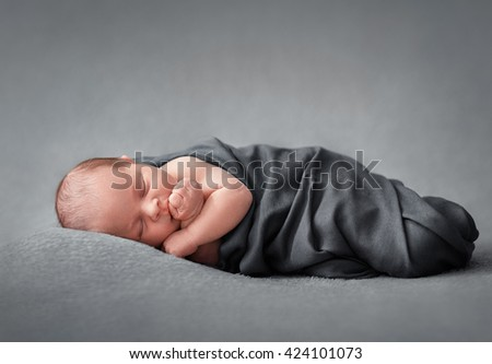 sleeping newborn baby on a blanket, nap time - stock photo
