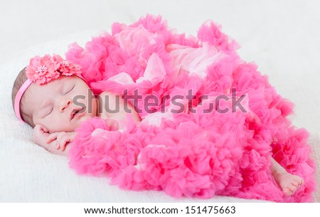 sleeping small princess in pink laces (the newborn girl) - stock photo