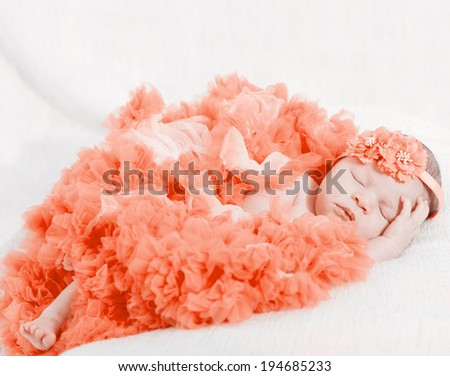 sleeping small princess in red laces (the newborn girl) - stock photo