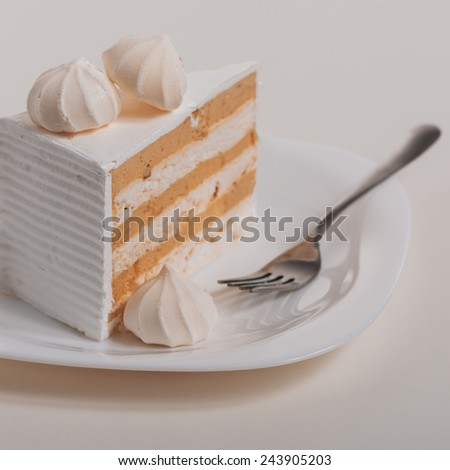 Slice of cake on plate, selective focus - stock photo