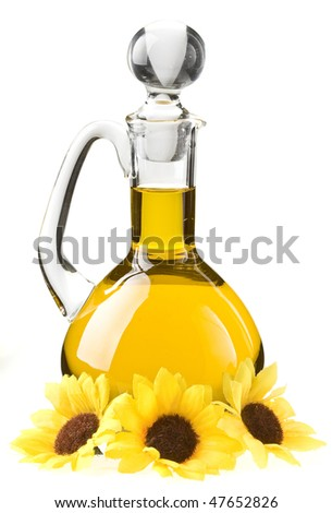 Small decanter with sunflower oil isolated on the white background - stock photo