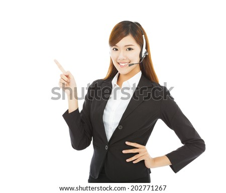 smiling business woman with headphone and point up - stock photo