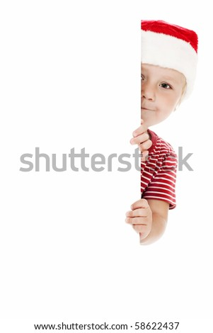 smiling child with xmas hat and white board - stock photo
