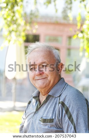 smiling elderly man - stock photo