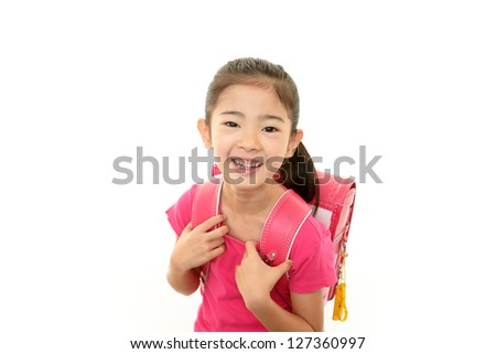 Smiling girl with backpack - stock photo