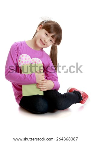 Smiling girl with book - isolated on white background - stock photo