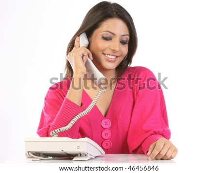 Smiling teenage girl chatting on the telephone - stock photo