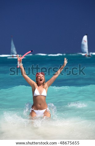 smiling woman holding snorkel gear and enjoy summer day - stock photo
