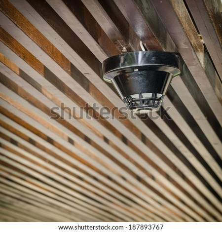 Smoke detector mounted on ceiling Wood  - stock photo