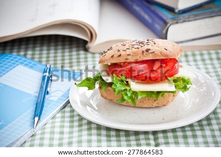 snack and textbooks - stock photo