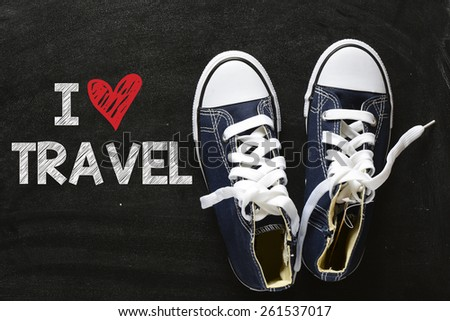 Sneakers with I love travel. Male sneakers with I love travel on the back background - stock photo