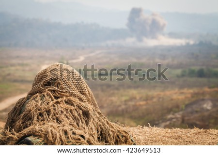 Sniper in camouflage suits on the ground - stock photo