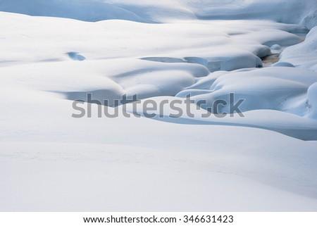Snow cover hillocks closeup in wintertime - stock photo
