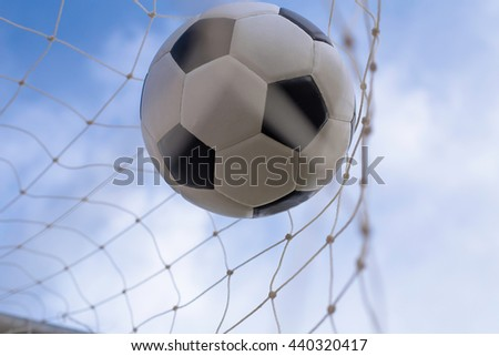soccer ball in a net - stock photo